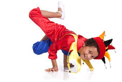 Breakdancing boy dressed in clown costume. Break a dance Royalty Free Stock Photo