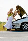 Breakdown. The picture shows two woman in trouble cause of a car breakdown Royalty Free Stock Photography