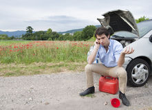 Breakdown call. Young man calling breakdown service Royalty Free Stock Image