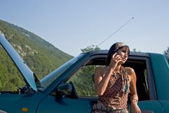 Breakdown of car. Woman breaking down of car and discussing with her telephone Stock Images