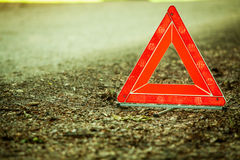 Breakdown of car. Red warning triangle sign on road Royalty Free Stock Images