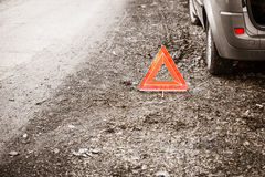 Breakdown of car. Red warning triangle sign on road Stock Images