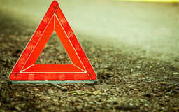 Breakdown of car. Red warning triangle sign on road Stock Photos