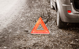 Breakdown of car. Red warning triangle sign on road Royalty Free Stock Photography
