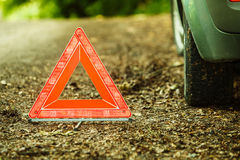 Breakdown of car. Red warning triangle sign on road Royalty Free Stock Photos