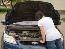 Breakdown car. Woman on the phone looking her crash breakdown car in a road Stock Photo