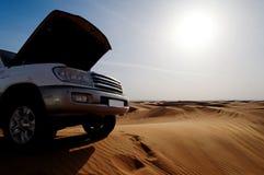 Breakdown in desert. Broken down car with open bonnet or hood in sandy desert royalty free stock images