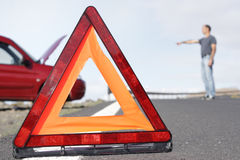Breakdown triangle. Accident breakdown scene with car person and warning triangle Stock Image