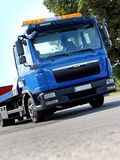 Breakdown vehicle. New blue breakdown vehicle with yellow signal lights Royalty Free Stock Photos