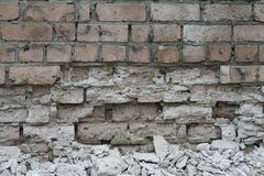 Breaked brick wall. Industrial background Stock Photos