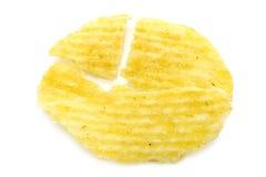 Breaked single potato chip close-up Stock Photo