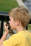 Breaker 1-9. A little boy playing with a walkie talkie Royalty Free Stock Photography