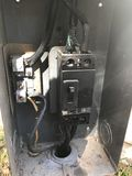 Breaker box struck by lightening. A breaker box after lightening hit the power lines showing burn damage Royalty Free Stock Photos
