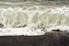 Breakers at a black beach Stock Photography