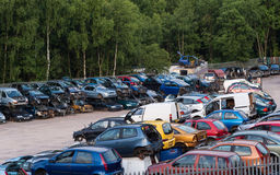 Breakers yard. Car scrapyard with rows of cars for recycling Royalty Free Stock Photos