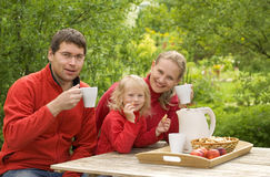 Breakfast. Happy family have a breakfast outdoors Stock Images