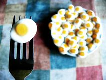 Breakfast. Small eggs for breakfast on the square table Royalty Free Stock Images