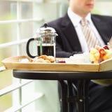 Breakfast. Business man enjoying breakfast Stock Image
