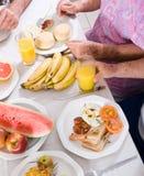 Breakfast. Group of senior people having breakfast together Royalty Free Stock Photos