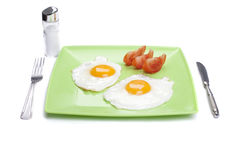 Breakfast. Fried eggs in plate isolated on white royalty free stock photos