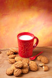 Breakfast. Red cup of milk and cookies. Copyspace above Royalty Free Stock Images