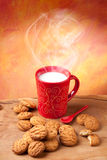 Breakfast. Steaming cup of milk and cookies Stock Photography