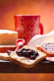 Breakfast. Healthy and nutrient breakfast: toast with butter and jam Stock Photos