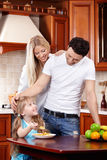 Breakfast. Parents look at the child which eats corn-flakes on kitchen royalty free stock photos