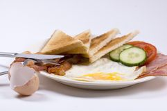 Breakfast. A complete breakfast with eggshells on the side royalty free stock photo