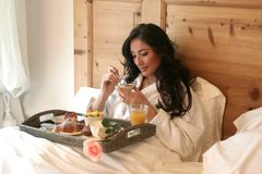 Breakfast 149. A  beautiful woman has breakfast in bed Royalty Free Stock Images