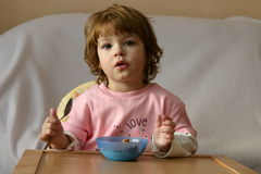 Breakfast. Child eating cereal for breakfast Stock Photography