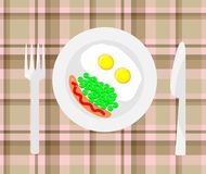 Breakfast. Fried eggs with sausage and peas Royalty Free Stock Photography