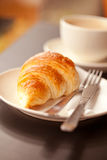 Breakfast. Cup of fresh coffe with croissant Royalty Free Stock Photo