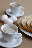 Breakfast. Lovely breakfast with coffe, three eggs and bread Stock Photos