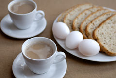 Breakfast. Lovely breakfast with coffe, three eggs and bread Royalty Free Stock Photo