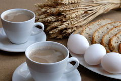 Breakfast. Lovely breakfast with coffe, three eggs and bread Royalty Free Stock Photography