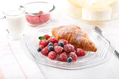 Breakfast. With croissant, berries and milk Stock Photos