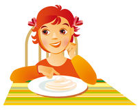 Breakfast. Little girl at breakfast with porridge Royalty Free Stock Photos