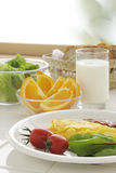 Breakfast. Breadfast on white tile table in dining room Stock Photo