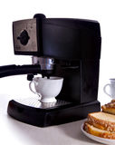 Breakfast. An espresso machine with a cup of coffee and sweets royalty free stock image