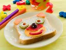 Breakfast. With funny sandwich for child with drink on background. Selective focus stock images