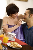 Breakfast. Healthy living: young couple having breakfast at home Royalty Free Stock Photo