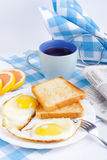 Breakfast. With crunchy toasts Coffey and newspaper Royalty Free Stock Image