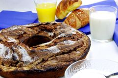 Breakfast. Rich breakfast with milk, orange juice and ciambellone Royalty Free Stock Photos