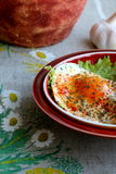 Breakfast. Fried egg with salad, tomato  and garlic in country style Stock Images