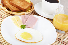 Breakfast. Fried eggs with cheese and ham stock images