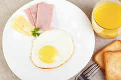 Breakfast. Fried eggs with cheese and ham royalty free stock images