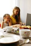 Before a breakfast. Work on a computer before a breakfast Royalty Free Stock Images