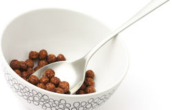 Breakfast. Chocolate corn flakes in a white bowl Stock Image