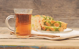 Breakfast. Delicious sweet pie with tea on on wooden table stock images